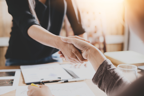business owner shaking hand with customer